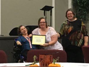 Photo of Rebecca Peterson and Nancy P accepting DSP of the Year 2017